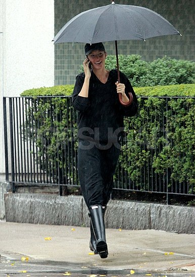 Gisele Bundchen took cover under an umbrella in Boston.