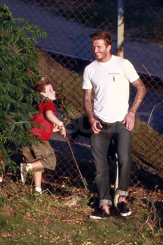 David Beckham and Cruz Beckham was at Romeo Beckham's soccer practice.