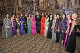 Kate Middleton and Prince William pose with ladies from the 100 Women in Hedge Funds charity.