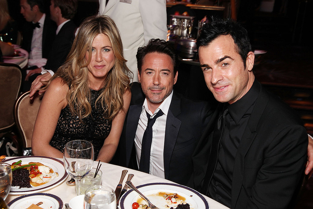 RDJ snapped a photo with Jennifer and Justin.
