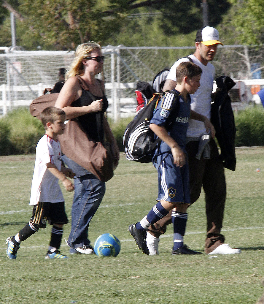 David Beckham left a soccer game with Cruz and Brooklyn.