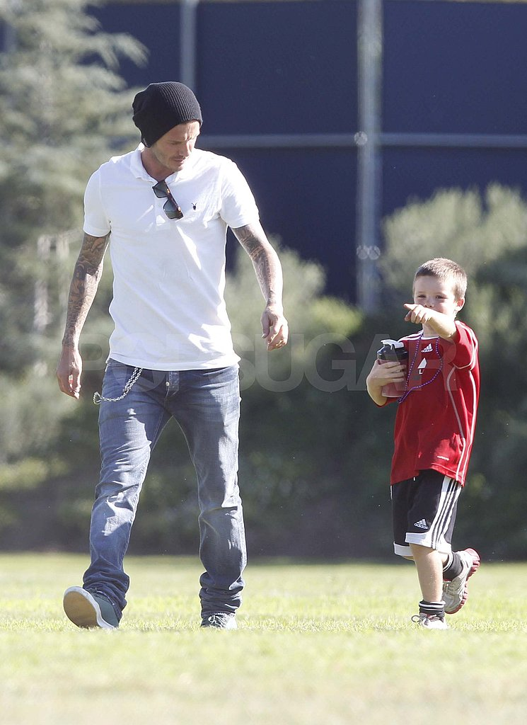 David Beckham with Cruz on the soccer field.