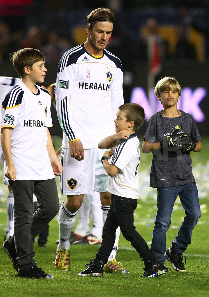 David Beckham took a victory lap around the soccer field with his boys Brooklyn, Cruz, and Romeo.