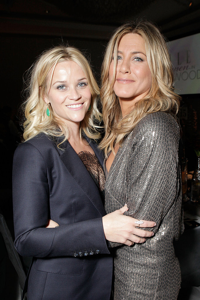 Jennifer Aniston and Reese Witherspoon wrapped their arms around each other backstage at Elle's Women in Hollywood Tribute.