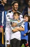 David Beckham hugged Brooklyn Beckham.