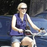 Kristen Bell carried her purse while biking.