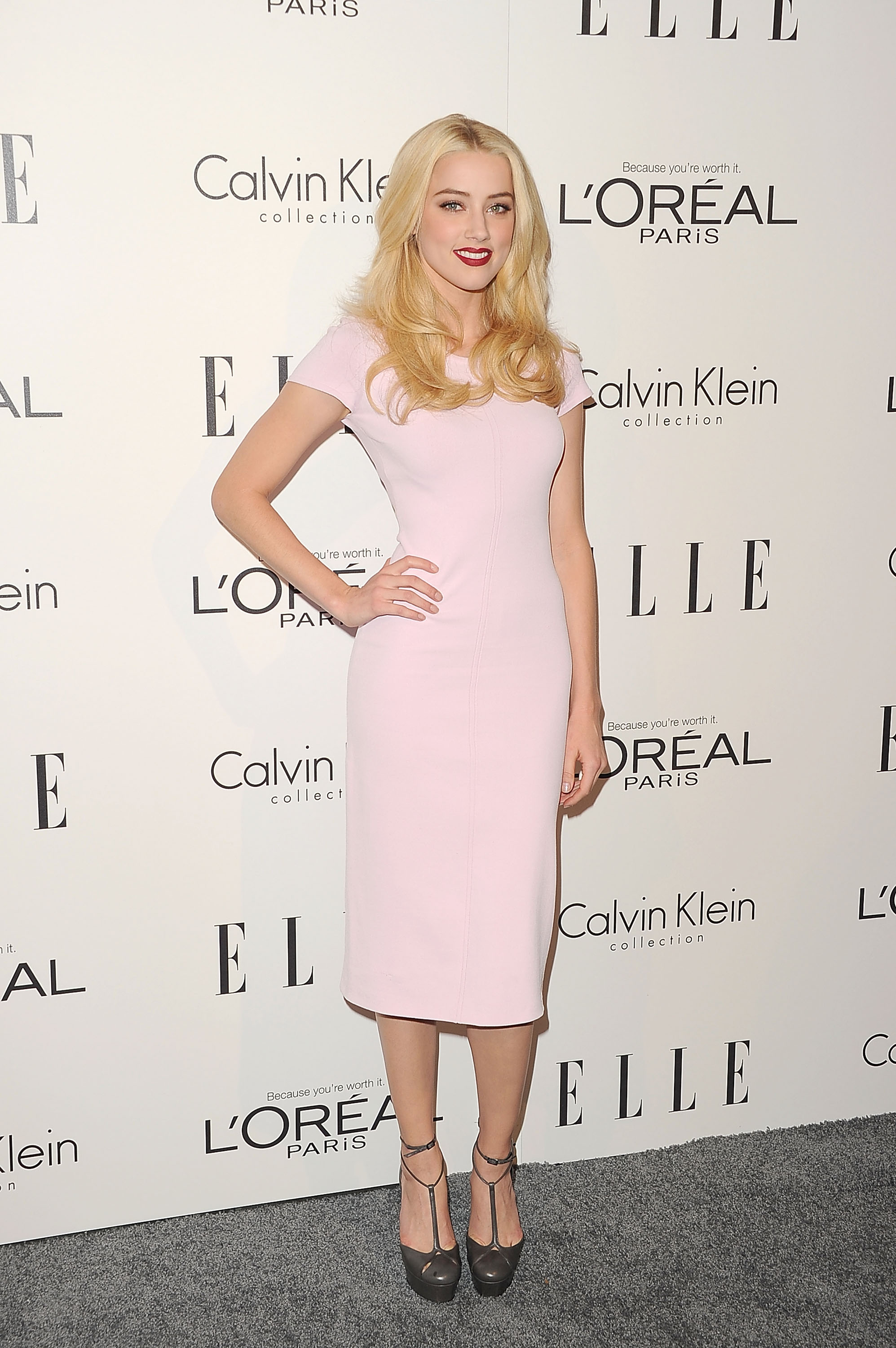 Amber Heard worked the red carpet in light pink.