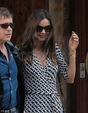 Miranda Kerr wore oversized sunglasses.