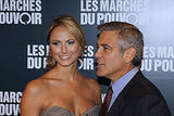 George Clooney and Stacy Keibler pose together at the Paris premiere of The Descendants.