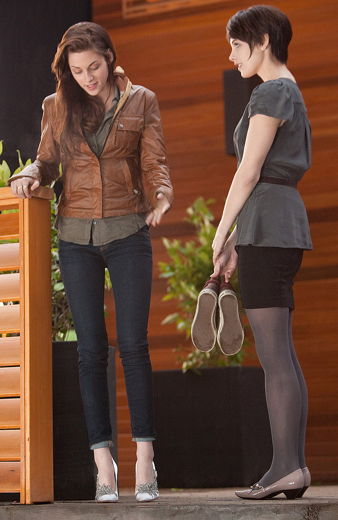 Ashley Greene helped Kristen Stewart, as Bella Swan, try on shoes in Breaking Dawn Part I.