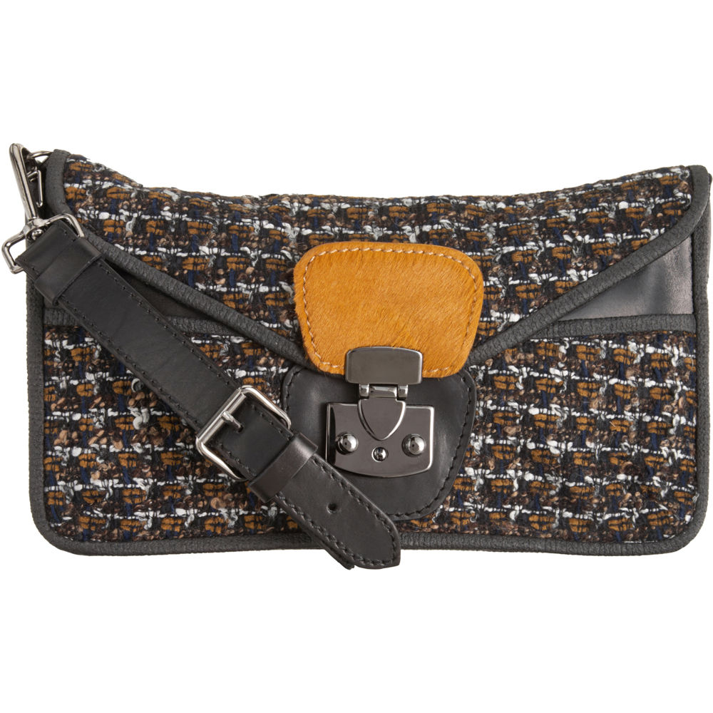 The tough metal buckles take the tweed from ladies-who-lunch to boarding-school-bad girl. Carven Tweed Shoulder Bag ($600)
