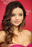 Miranda Kerr flashed a coy grin for photographers.