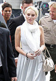 Lindsay Lohan held a gold bag at court.