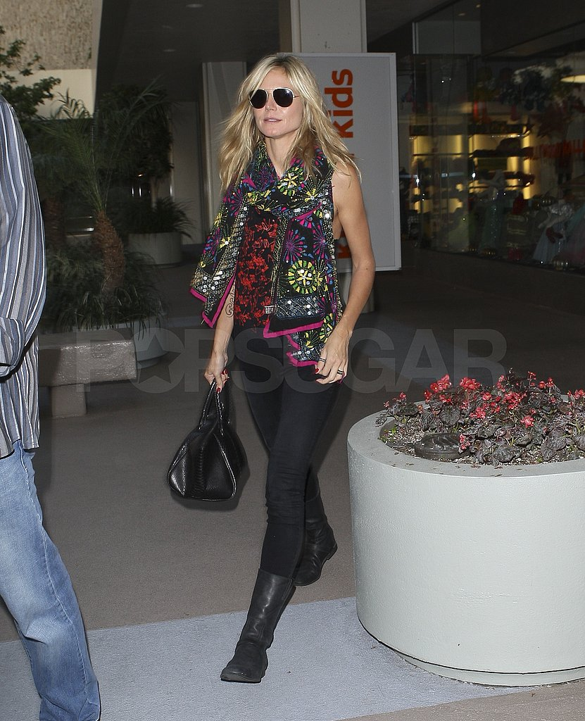 Heidi Klum shopped solo wearing an Exclusively.In scarf.