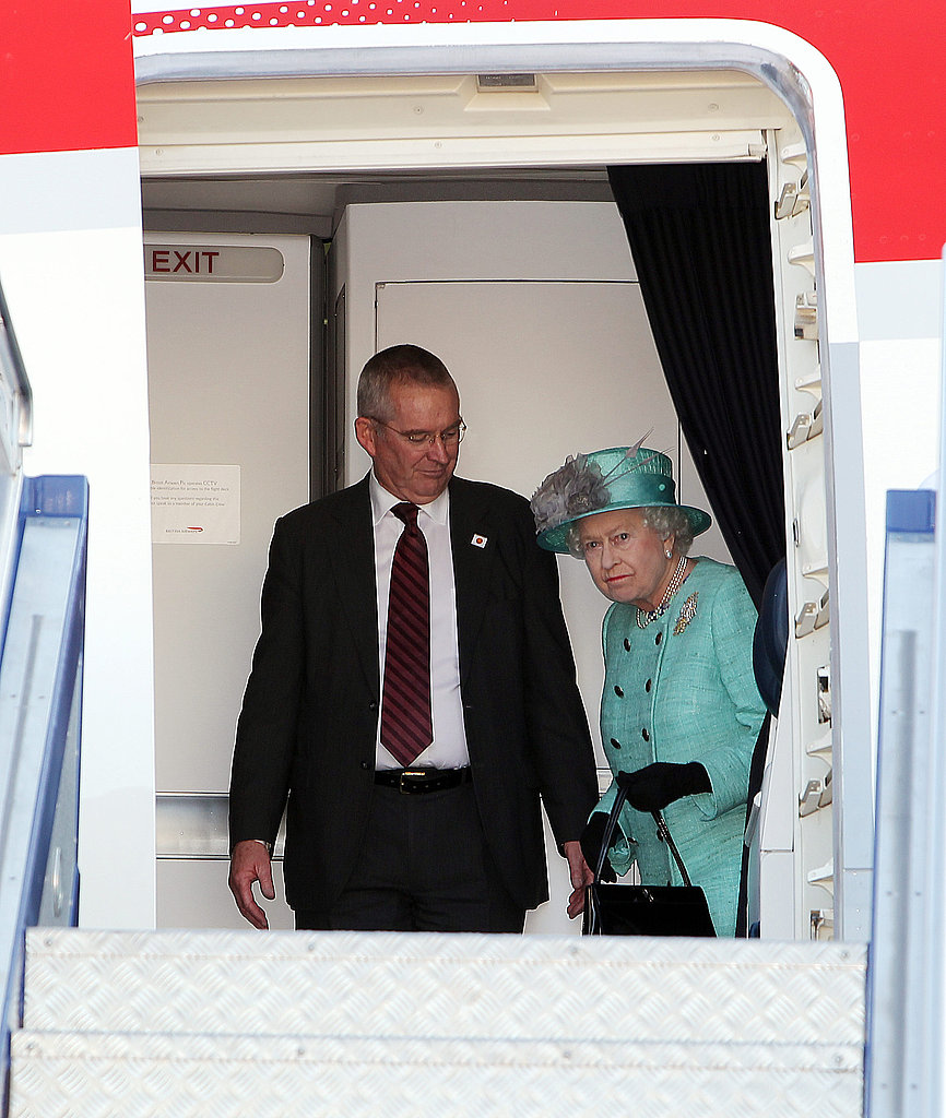 The queen prepares to step off the plane.