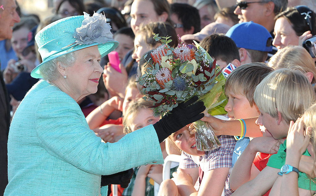 Queen Elizabeth gets lots of flowers in Australia.