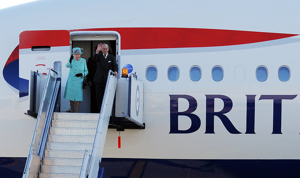 The queen and Prince Philip arrive on their chartered British Airways jet.