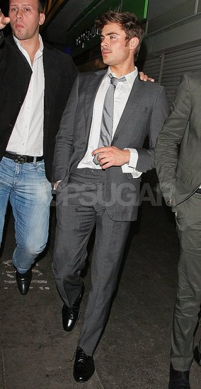 Zac Efron wore a sleek grey suit to The Box in London.