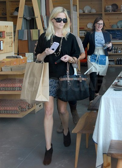 Reese dressed in a floral skirt and black top for her latest shopping trip.