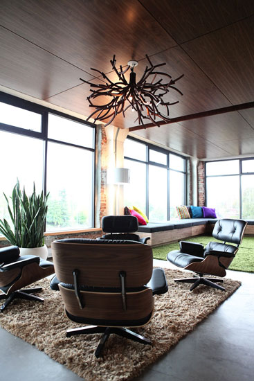 Work doesn't have to mean drab office chairs; Pixar opted for modern Eames-style furnishings to highlight the office's breathtaking seaside views. The design also incorporates natural elements of Vancouver, such as the use of locally sourced cedar wood.    Images courtesy of Pixar