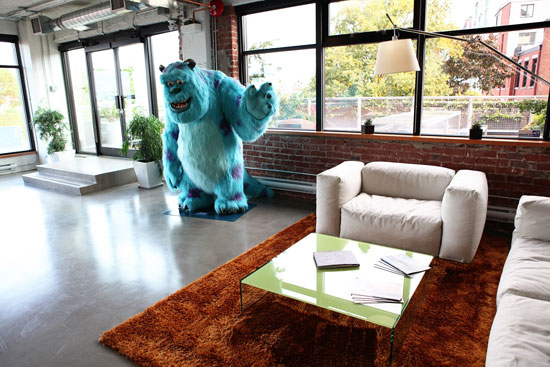 Sulley maintains his post as office greeter in the main meeting area and path to the communal, outdoor patio.   Images courtesy of Pixar