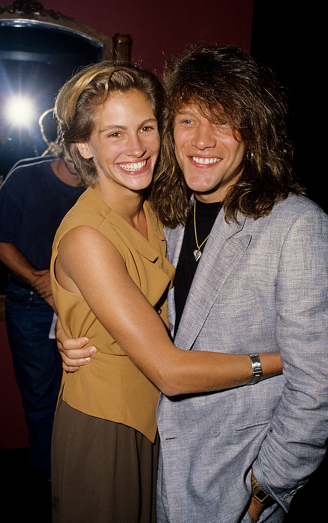 Julia Roberts gave Jon Bon Jovi a squeeze at the Young Guns II premiere in July 1990.