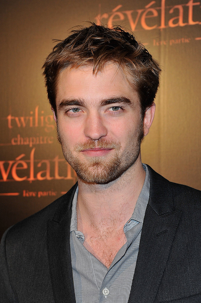 Robert Pattinson flaunted his dashing good looks in Paris.