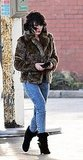 Scarlett Johansson arrived on set in acid washed jeans and a fur jacket.