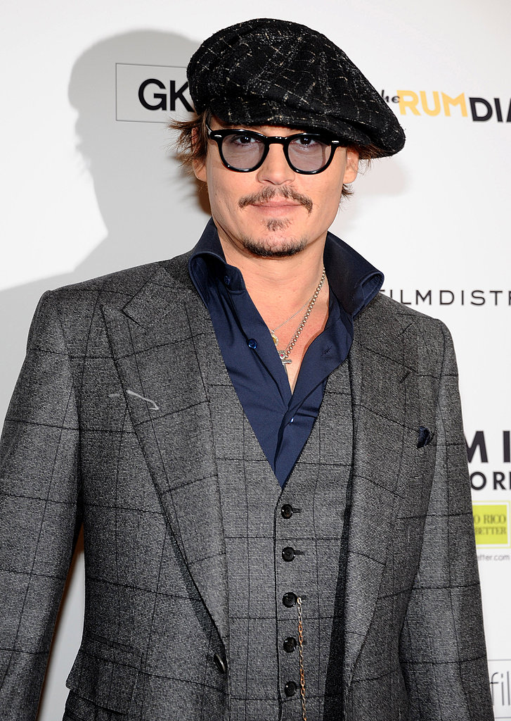 Johnny Depp buttoned up for the MOMA affair.