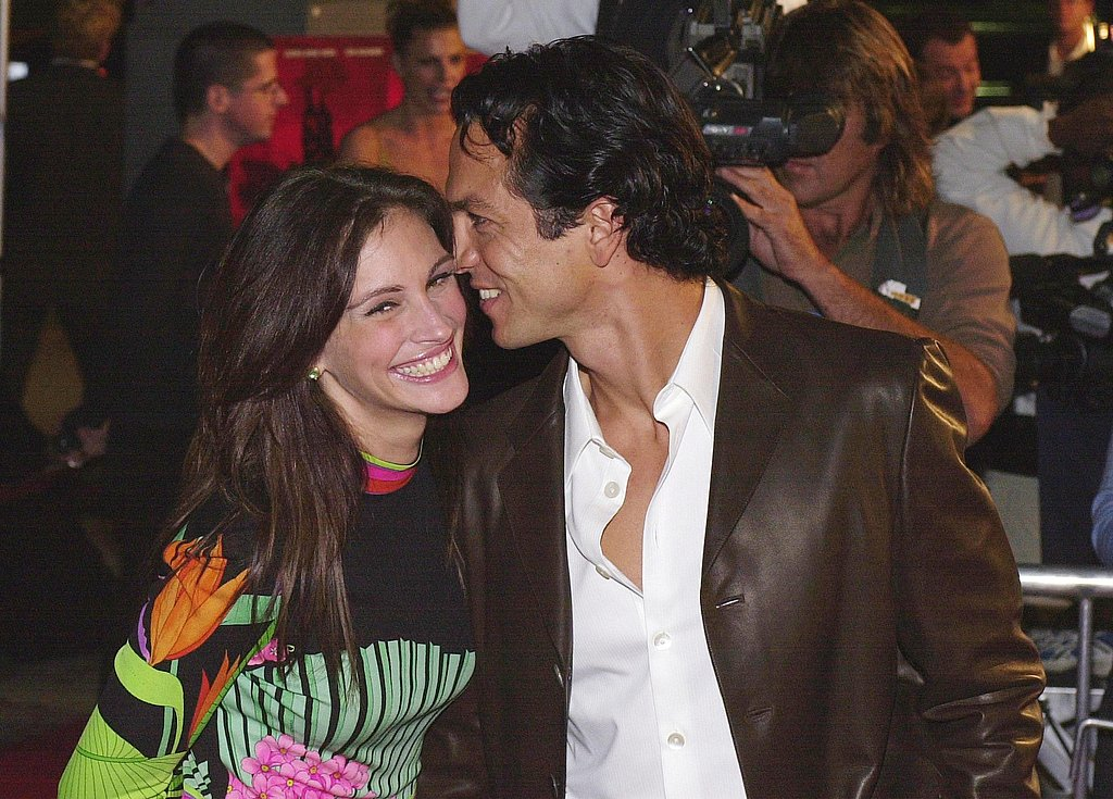 Julia Roberts shared a sweet red-carpet moment with Benjamin Bratt at the Red Planet premiere in 2000.