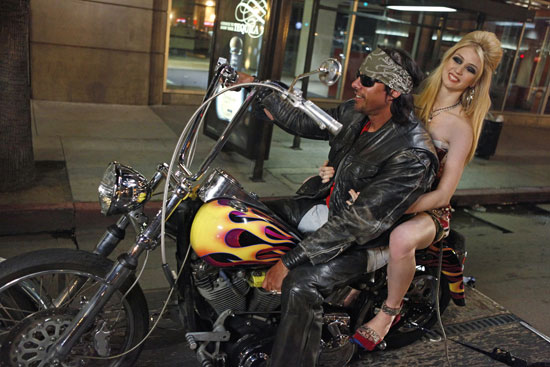A moving trailer dragged a motorcycle through Hollywood Boulevard during the photo shoot.  Photo courtesy of The CW