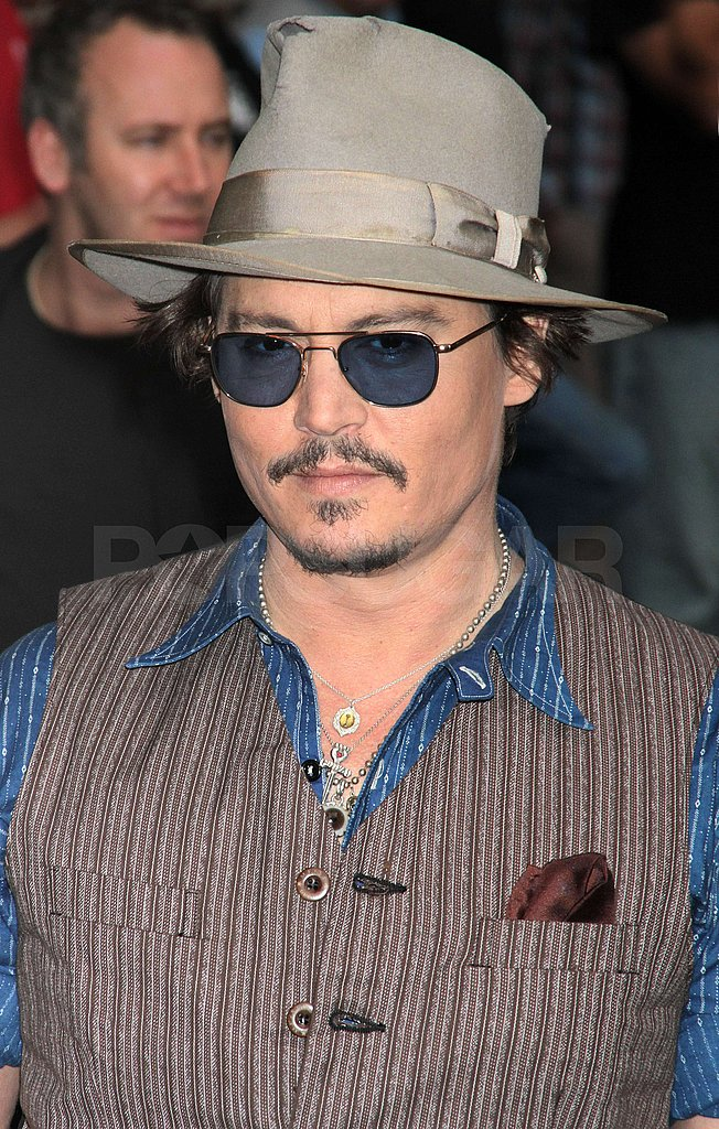 Johnny Depp wore his signature sunglasses and hat.