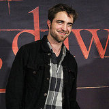Robert Pattinson smiled on the red carpet in Brussels.