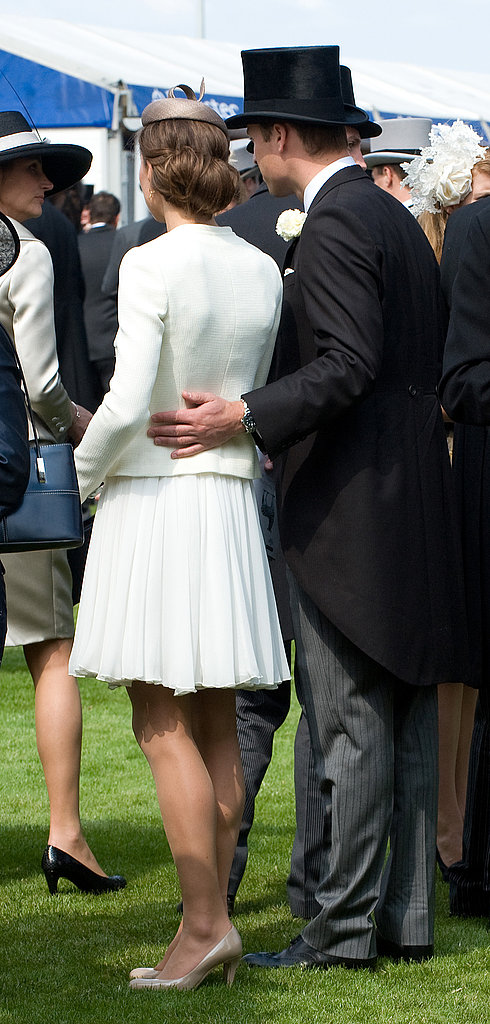 William put his arm around Kate during a day at the races in June 2011.