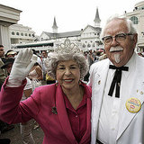 This Queen Elizabeth II copycat is hanging out with a Colonel Sanders look-alike.