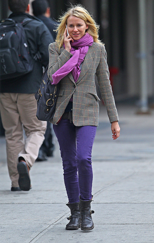 Naomi Watts with purple pants.