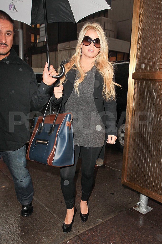 Jessica Simpson wore a gray sweater.