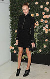 Kate Bosworth posed before a wall of roses.
