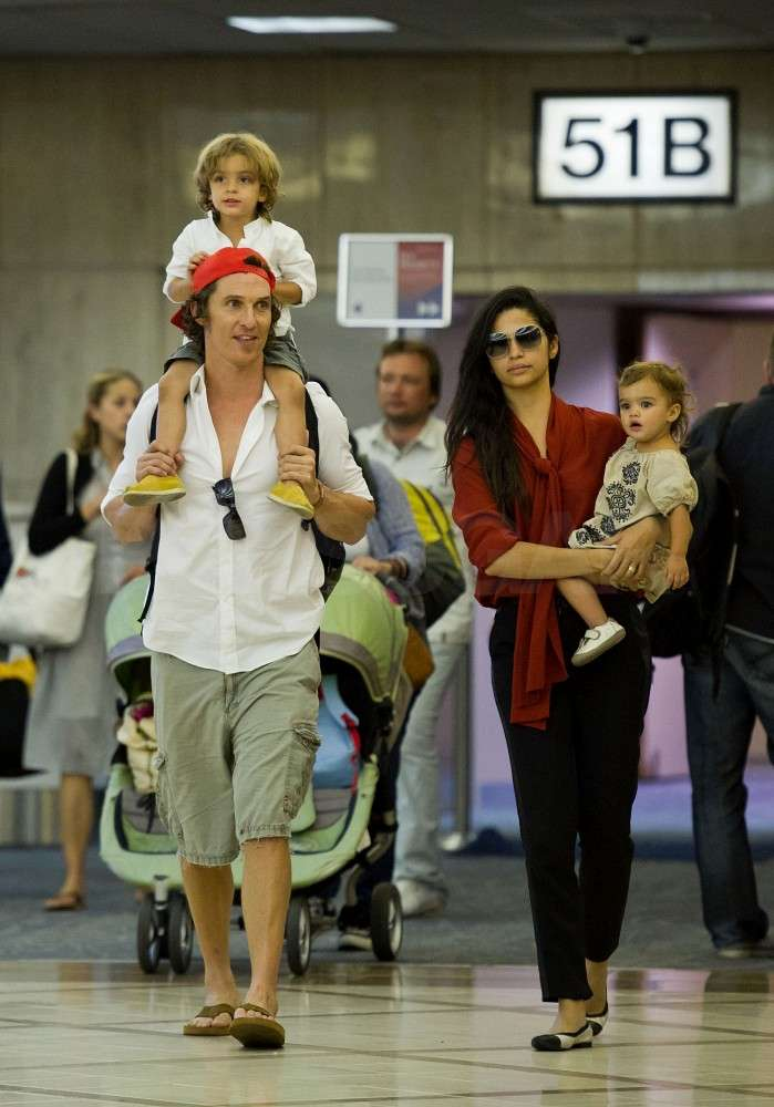 Matthew McConaughey carried Levi on his shoulders when the family arrived at LAX in September 2011.