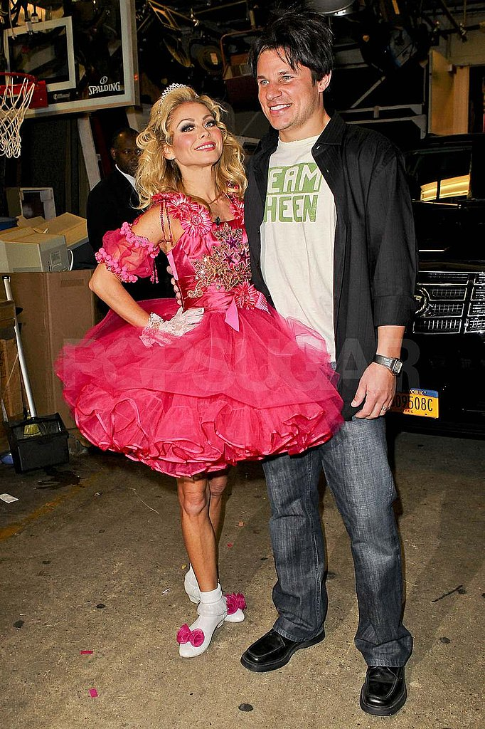 Nick Lachey in a Charlie Sheen costume with Kelly Ripa.
