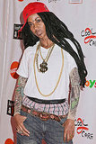 Holly Robinson Peete goes all out, from her hair to her teeth, to be Lil Wayne.