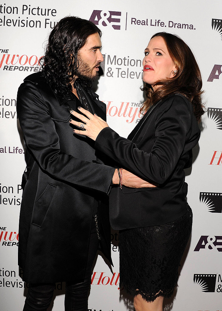 Russell Brand hugged his Arthur costar Jennifer Garner.