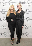 Jessica Simpson and Ashlee Simpson dressed in black at an event for her Jessica Simpson Girls line in November 2011.