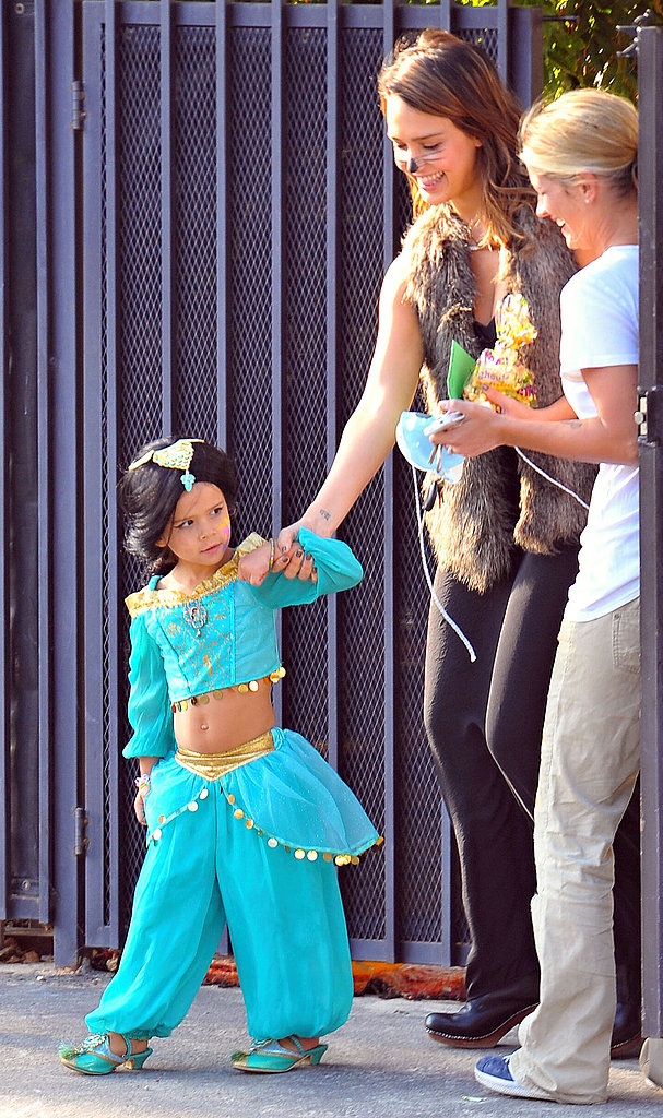 Jessica Alba held the hand of Princess Jasmine, aka Honor Warren, in 2011.