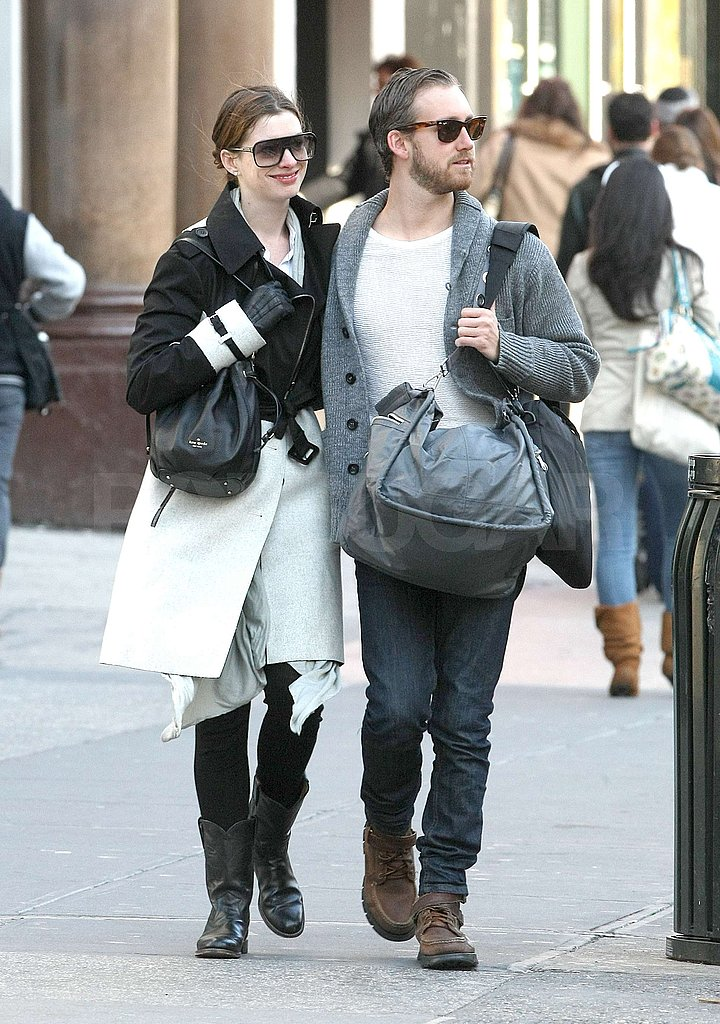 Anne Hathaway and Adam Shulman cuddled close.