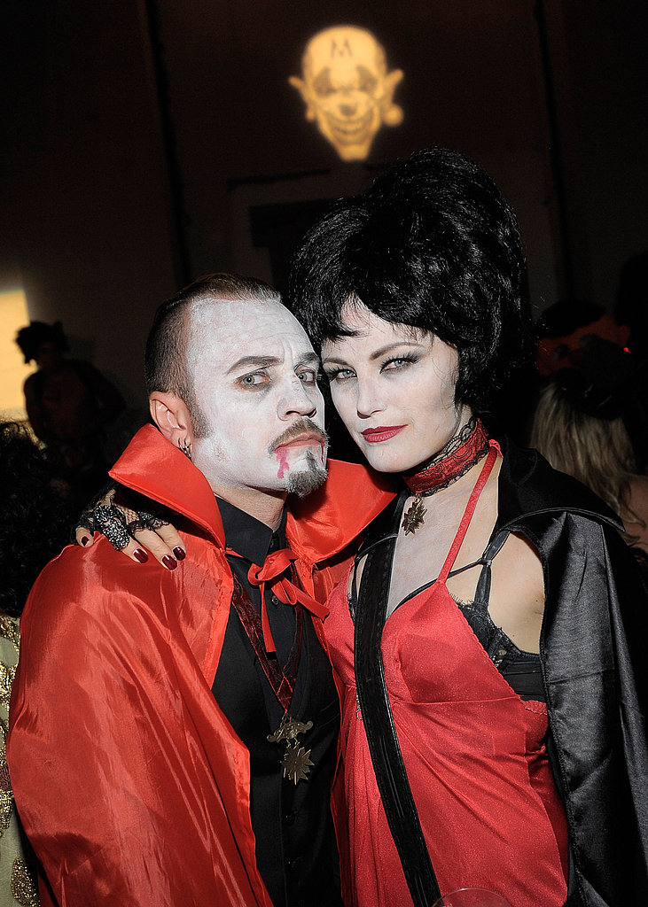 Malin Akerman and her husband Roberto Zincone make their best deathly stare in vampire costumes.