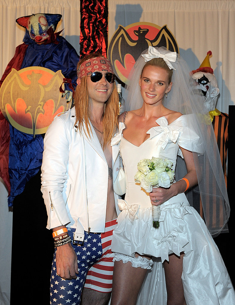 "Maroon 5 frontman Adam Levine and model Anne V channeled Axl Rose and Stephanie Seymour from the Guns 'n' Roses music video for ""November Rain."" Creative!"