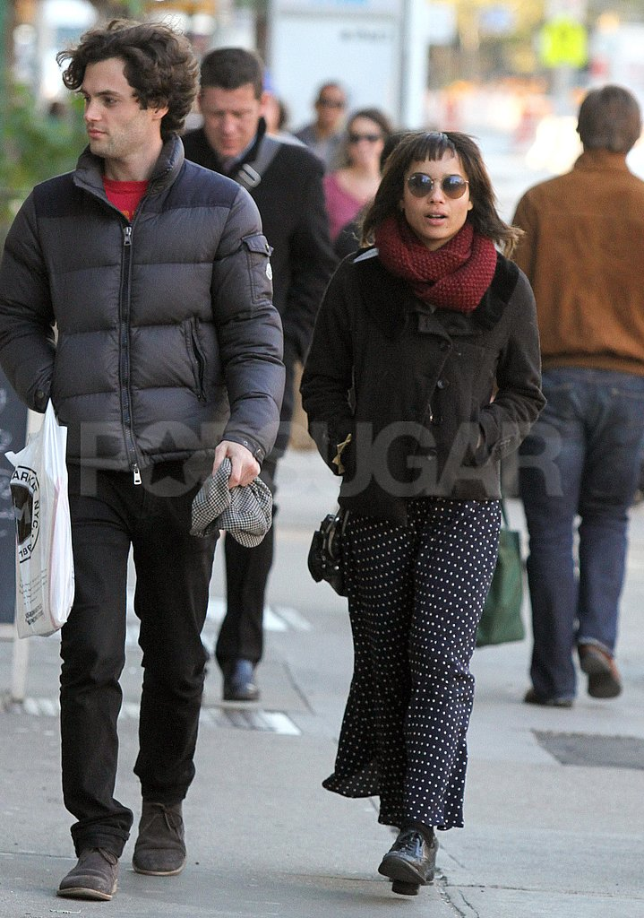Penn Badgley and Zoe Kravitz buttoned up for a walk.