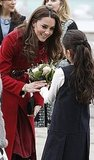 Kate is greeted with flowers.