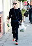 Reese Witherspoon with green drink.